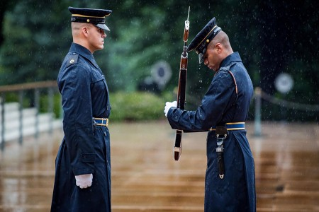 Soldiers assigned to the Tomb of the Unknown Soldier, 3rd U.S. Infantry Regiment (The Old Guard), continue their solemn duty despite inclement weather at the Tomb of the Unknown Soldier, Arlington National Cemetery, Va. No matter the weather, Tomb Se...
