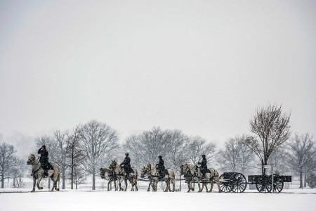The 3rd U.S. Infantry Regiment (The Old Guard) Caisson Platoon, support a funeral during heavy snowfall at Arlington National Cemetery, Arlington, Va., March 21, 2018.