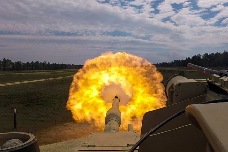 Troopers fire the main gun round at a target during unit gunnery, March 29, at Fort Stewart, Ga. This gunnery marked the first time 2nd Armored Brigade Combat Team, 3rd Infantry Division, troopers fired their newly received M1A1-SA Abrams Tanks since the brigade converted from a light to an armored brigade combat team.
