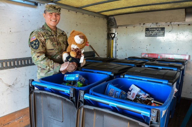 FORT BENNING, Ga. (Dec. 14, 2018) -- Chaplain (Maj.) Eric Park holds up a toy collected during the 199th Infantry Brigade's toy drive. Soldiers assigned to the 199th Infantry Brigade here donate toys to the Columbus, Georgia, Valley Rescue Mission Dec. 13. The brigade's toy drive, which began Nov. 5, supported Valley Rescue Mission with brand new, unused toys for children whose families cannot provide them with gifts this holiday season. (U.S. Army photos by Megan Garcia, Maneuver Center of Excellence, Fort Benning Public Affairs)