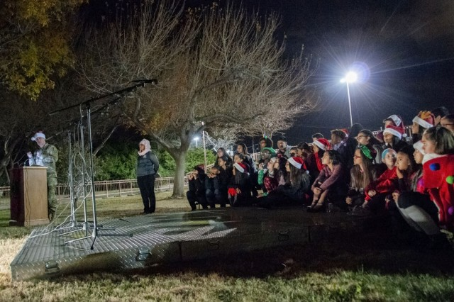 Soldiers, staff and families welcome the holiday season during William Beaumont Army Medical Center's annual Holiday Tree Lighting Ceremony, Dec. 6.