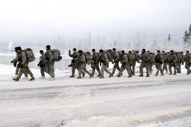 Soldiers assigned to Fort Wainwright conduct a ruck march Dec. 11 in single degree temperatures. With temperatures that drop to 40 degrees below zero and colder, Arctic Warrior Soldiers in Alaska's interior train year round to stay lethal and ready to fight in any environment. (Photo by Daniel Nelson, U.S. Army Garrison Alaska Fort Wainwright Public Affairs)