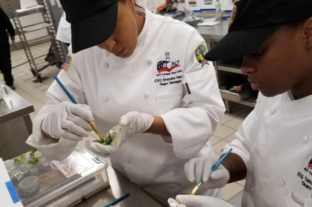 Chief Warrant Officer 2 Shemika Harris, Theater Food Advisor of the 8th Theater Sustainment Command and Staff Sgt. Takijah Pettigrew, assigned to Indo-PACOM prepare garnish at the 2018  Villeroy and Boch World Cup competition in Luxembourg, Nov. 24-28.  The Villeroy and Boch World Cup is one of the largest cooking competitions in the world with professional and industry chefs from around 75 different nations. Joint Team Hawaii received a bronze medal for their cold food display layout and a ranking of 11 out of 45 regional teams