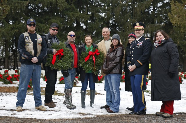 From left to right: Dan Hoagland, Tom Gray, and Tom Spencer, all veterans with the American Legion Riders, Jamie Lynn Mendelson, event organizer, Sgt. 1st Class Robert Owen, a combat engineer with the 41st Engineer Battalion, 2nd Brigade Combat Team, 10th Mountain Division, Melissa Owen, Stephanie Beaulieu, Lt. Col. James Beaulieu, 41st EN commander, and Molly Reilly, mayor of Sackets Harbor, pose for a photo during the second annual Sackets Harbor Military Cemetery wreath laying ceremony in honor of National Wreaths Across America Day, in Sackets Harbor, New York, December 15, 2018. This past fall, Owen led 41st EN Soldiers, with assistance from the American Legion Riders, during a volunteer project to clean and maintain the cemetery. Mendelson, a college freshman, helped organize the event as a community service project during her senior year in high school, with help from Shari Simmons, who donated the wreaths from Simmons Farm in Copenhagen. (U.S. Army photo by Staff Sgt. Paige Behringer)