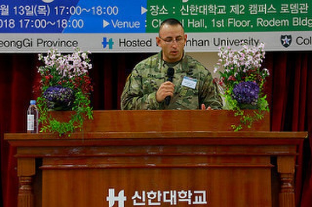 GYEONGGI PROVINCE, Republic of Korea - Guest speaker, Maj. Anthony Clas, a native of Chicago, public affairs officer, 3rd Armored Brigade Combat Team, 1st Armored Division, gives remarks to graduates about the enduring ROK-U.S. alliance during the 2018 Head Start Program Closing Ceremony at Shinhan University Dec. 13. The program allows graduates to gain a deeper appreciation of Korean culture and fosters a climate of mutual respect with the host nation. (U.S. Army photos by Sgt. Alon J. Humphrey, 3rd ABCT, 1st AD Public Affairs)