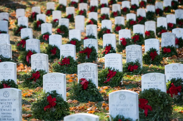 Wreaths are placed on memorial markers in Arlington National Cemetery's Section E during the Wreaths Across America event in Arlington, Va., Dec. 16, 2017.