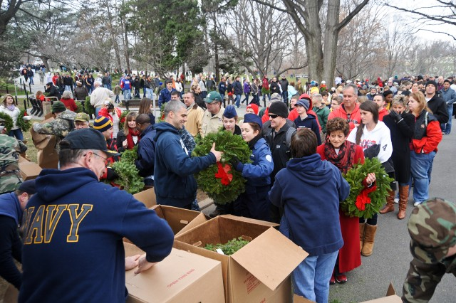 Navy personnel from the Navy International Programs Office, Washington, distribute wreaths to volunteers during the Wreaths Across America event at Arlington National Cemetery, Va., Dec. 15, 2012.