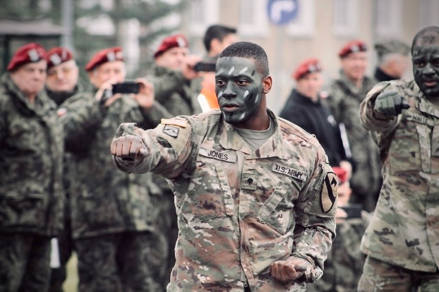 A Soldier participates with Polish Soldiers for a combatives demonstration in Boleslawiec, Poland, Nov. 9, 2018. The 91st Brigade Engineer Battalion, 1st Armored Brigade Combat Team, 1st Cavalry Division,  has participated in a number of joint activities with the host Polish 23rd Field Artillery Regiment in Boleslawviec in order to strengthen interoperability between U.S. and NATO forces to support Atlantic Resolve in Europe.