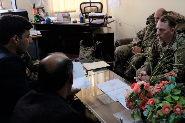 Marmal Detachment Commander sits in on a key leader engagement with partners to increase operational capabilities of the Afghan National Army by providing quality facilities. (Staff Sgt. Andrew Pretty)