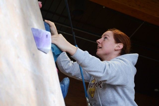 LIVERPOOL, N.Y. - Sgt. 1st Class Nicole Lyon, a senior materials specialist from U.S. Army Reserve European Command and a native of Lynn, Mass., scales a rock climbing wall during a wounded warrior recreation therapy event in Liverpool, N.Y. Dec. 12.  The day-long trip, hosted by 3rd Battalion, 85th Mountain Infantry Warrior Transition Battalion, was a therapeutic event designed to provide wounded warriors the opportunity to conduct a physical activity while socializing with other wounded warriors.  (Photo by Warren W. Wright Jr., USA MEDDAC Fort Drum Public Affairs)
