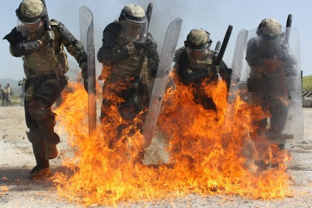 Soldiers conducted fire phobia training, at Camp Marechal de Lattre de Tassigny, Kosovo, May 2, 2018. The training familiarizes crowd riot control forces with tactics and techniques for reacting to and mitigating the threat of improvised incendiary d...