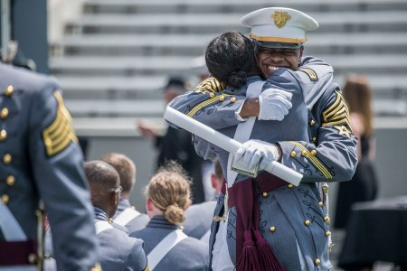 A U.S. Military Academy cadet reacts happily after receiving their diplomas during their graduation ceremony, May 26, 2018, at West Point, N.Y.