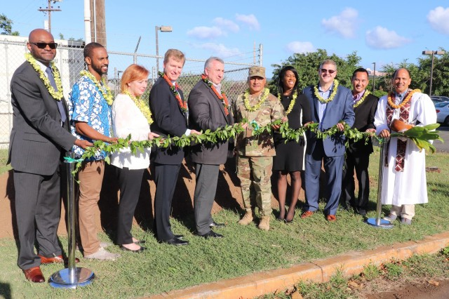 Leaders from the U.S. Army Intelligence and Security Command (INSCOM) Ground Intelligence Support Activity (GISA), Assistant Chief of Staff, G-6, and the U.S. Army Corps of Engineers Honolulu District prepare to break grounds for the GISA-Pacific Enterprise Scalable Data Center (ESDC) during a groundbreaking ceremony at Fort Shafter, Hawaii, Dec. 6.  Photographed from left to right are Shawn Hazel, NAB project manager; Kris Carey from Mortenson Company; Gwendolyn Conger, GISA facilities engineer; Michael Canna, INSCOM GISA director and assistant chief of staff, G6; Col. Arnold Iaea, GISA-Pacific, chief; Charise Byers, NAB Installation Support Section acting chief; Jamie Hagio, POH construction branch chief; and Kahu Kordell Kekoa.