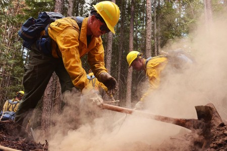A Soldier with with 176th Engineer Company, clears hot spots along the fire line of the Sheep Creek fire, Aug. 5, 2018, near Northport, Wash. Price is a member of a 20-person hand crew that is one of five crews made up of Washington Army and Air National Guardsmen.