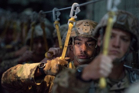 Paratroopers prepare to jump out of an Illinois Air National Guard C-130 Hercules while conducting airborne training at Joint Base Elmendorf-Richardson, Alaska, Aug. 8, 2018. The Soldiers of 4th Infantry Brigade Combat Team (Airborne), 25th Infantry ...