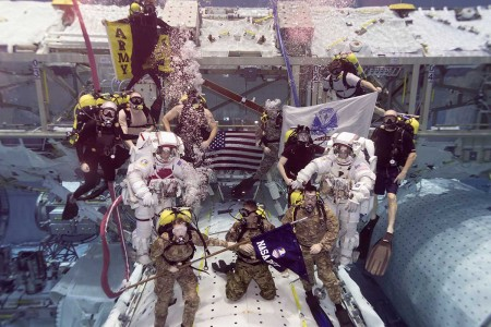"""Army astronauts Col. Andrew """"Drew"""" Morgan and Lt. Col. Anne McClain, both from the astronaut class of 2013, prepare to be promoted while underwater following required training in the Neutral Buoyancy Laboratory at the Sonny Carter Training Facility in Houston, Texas, Sept. 27, 2018."""