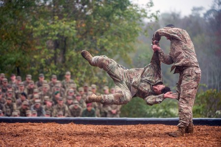Two Soldiers with the Airborne and Ranger Training Brigade demonstrate hand-to-hand combat maneuvers during the Rangers In Action demonstration preceding the Ranger Course graduation at Fort Benning, Georgia on October 26, 2018.