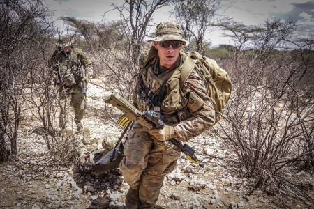 Paratroopers provide emergency medical care to a simulated casualty during a live-fire exercise alongside British paratroopers, Nov. 16, 2018, in Kenya, Africa, as part of Operation Askari Storm. Paratroopers with 508th Parachute Infantry Regiment, 3rd Brigade Combat Team, 82nd Airborne Division, participated in the international partner training operation.