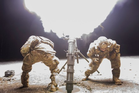 Army indirect fire infantrymen assigned to 4th Infantry Brigade Combat Team (Airborne), 25th Infantry Division, operate the M121 120 mm mortar system during live-fire training at Joint Base Elmendorf-Richardson, Alaska, Nov. 19, 2018. During the live...