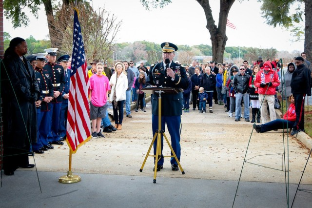 """FORT BENNING, Ga. (Dec. 15, 2018) - Fort Benning honors the memory of the nation's military veterans Dec. 15 with a wreath-laying ceremony that marked the first time the post has taken part in National Wreaths Across America Day. The event, observed at memorial sites nationwide and elsewhere on the third Saturday in December, is organized by the non-profit Wreaths Across America, whose core theme is """"Remember our fallen U.S. veterans, Honor those who serve, Teach your children the value of freedom."""" (U.S. Army photos by Markeith Horace, Maneuver Center of Excellence, Fort Benning Public Affairs)"""