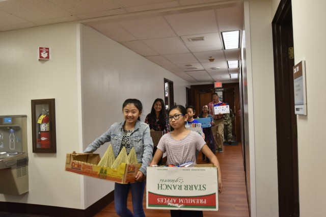 Student council leaders from Moanalua Elementary School bring Christmas ornaments to Tripler Army Medical Center to decorate the hospital for the holidays, handmade by approximately 500 students, Dec. 14.