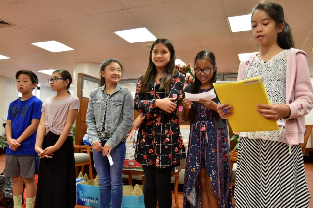 Student council leaders from Moanalua Elementary School present touching remarks to members of the Tripler Army Medical Center command team before donating Christmas ornaments to the hospital, Dec. 14.