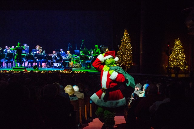 "COLUMBUS, Ga. (Dec. 17, 2018) - Theodore ""Dr Seuss"" Geisel's Grinch character visits audience members. The Maneuver Center of Excellence Band from Fort Benning, Georgia, played a concert of classic and modern holiday music Dec. 15 at the RiverCenter for the Performing Arts in downtown Columbus, Georgia. (U.S. Army photo by Patrick Albright, Maneuver Center of Excellence, Fort Benning Public Affairs)"