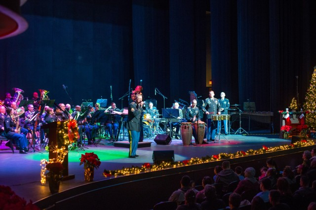 COLUMBUS, Ga. (Dec. 17, 2018) - Staff Sgt. Richard Scarlett provides the solo vocal work. The Maneuver Center of Excellence Band from Fort Benning, Georgia, played a concert of classic and modern holiday music Dec. 15 at the RiverCenter for the Performing Arts in downtown Columbus, Georgia. (U.S. Army photo by Patrick Albright, Maneuver Center of Excellence, Fort Benning Public Affairs)