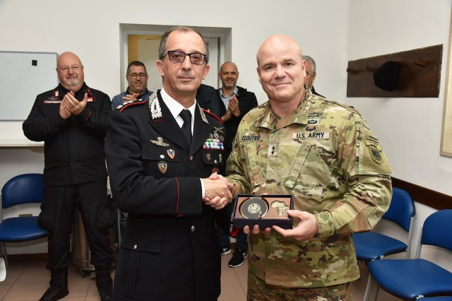 Maj. Gen. Roger L. Cloutier, the U.S. Army Africa commander (right), presents the USARAF crest to Italian Lt. Col. Lucio Merlo, Southern European Task Force Carabinieri commander, during his farewell ceremony at Caserma Ederle in Vicenza, Italy, Nov. 19, 2018. (U.S. Army Photo by Paolo Bovo)