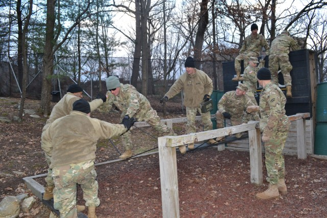 "Officers and Non-Commissioned Officers assigned to the 642nd Aviation Support Battalion, New York Army National Guard, work together on the ""river crossing"" obstacle at the United States Military Academy Leadership Reaction Course at West Point, N.Y. on Dec. 8, 2018. The training was designed so 642nd senior leaders could test their problem solving and decision-making skills while learning how to work better together."