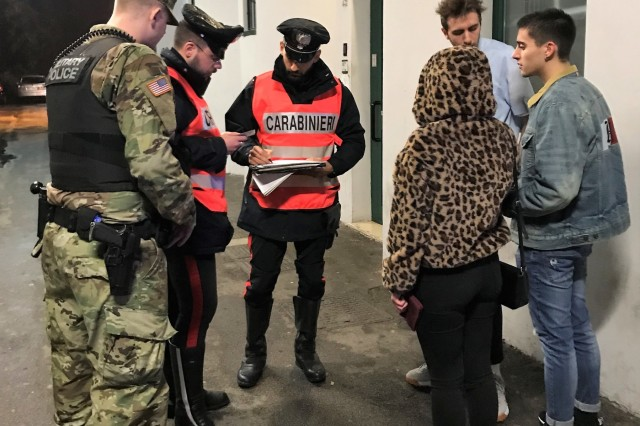 VICENZA, Italy - Italian Carabinieri assigned to the South European Task Force, Vicenza, and and Military Police personnel from U.S. Army Garrison Italy Provost Marshal Office, conducted random ID checks at the entrance of a night club in Vicenza during a joint patrol Nov. 24. In addition to creating a presence at the premises of the trendiest clubs and discos in Vicenza, the coordinated patrol also aims to enhance mutual understanding and interoperability between the Italian and American law enforcement units.