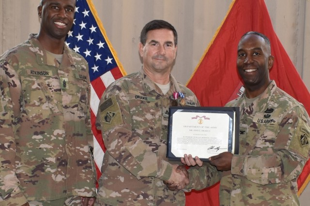 Deputy District Engineer for Programs and Project Management Directorate (PPMD) John E. Drake II is presented the Superior Civilian Service Award by Afghanistan District Commander, Col. Jason E. Kelly and Senior Enlisted Advisor, Command Sergeant Major Nathaniel Atkinson as he ended his overseas tour.  (Photo by Susan Murphy, Afghanistan District Executive Officer)