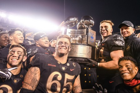 West Point football players and head coach, Jeff Monken, pose with the Commander-in-Chief's Trophy during the 119th Army-Navy Game in Philadelphia, Pa., Dec. 8, 2018.  The Army defeated the Navy for their third year in a row.