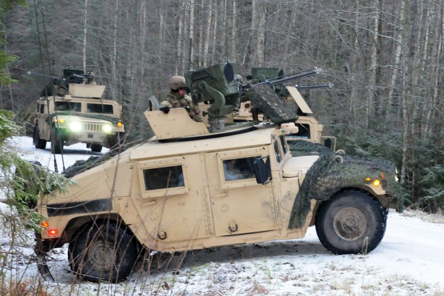U.S. Army Soldiers assigned to 2nd Battalion, 12th Cavalry Regiment, 1st Armored Brigade Combat Team, 1st Cavalry Division form a road block during Christmas Thunder, a training exercise with Estonian Soldiers held near Ahja, Estonia, Dec. 12, 2018. The Soldiers are in Estonia in support of the 1st ABCT Atlantic Resolve rotation across Europe, which is to improve the interoperability between U.S. Forces and their NATO allies and partners.