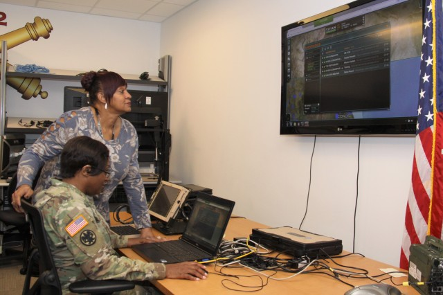 Capt. Tawanda Baxter and Flora Marshall, of Army Project Manager Mission Command, demonstrate the Tactical Interface Tracking Application Node at Aberdeen Proving Ground, Maryland, on Dec. 4, 2018.