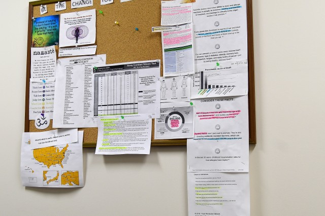 Brent Newell, from the Fort Knox Army Wellness Center, uses his cork board to help clients understand the importance of eating, sleeping and living right.