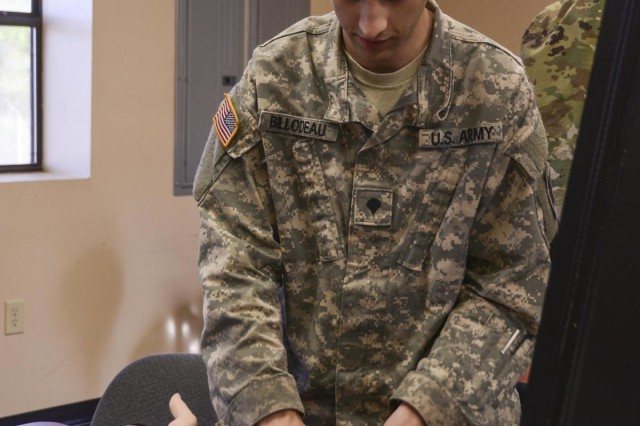 Louisiana Army National Guard's Spc. Brett Billodeau, a Sulphur, Louisiana native, applies an IV during Tactical Combat Casualty Care training at Camp Beauregard in Pineville, Louisiana, Dec. 2, 2018. Billodeau is assigned as a medic with Headquarters and Headquarters Company, 3rd Battalion, 156th Infantry Regiment, 256th Infantry Brigade Combat Team in Lake Charles, Louisiana.