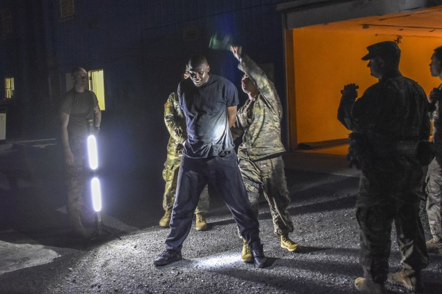 A hostile protester is handcuffed and placed in detention to hand over to local police in a training exercise in the Virgin Islands. The units participating in Caribbean Thunder from Michigan include: Michigan National Guard Joint Staff, 177th Military Police Brigade, 210th Military Police Battalion, 1775th and 1776th Military Police Companies. Participating from the Virgin Islands are the Virgin Islands National Guard, Port Authority, and Police Departments. Providing aviation support is the 172nd Air Wing of the Mississippi National Guard.