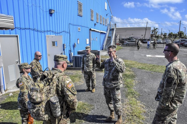 Lt. Col. Stemitz provides guidance for planners from the 177th Military Police Brigade as they construct realistic training for Michigan National Guard Soldiers. The Michigan National Guard is partnered with the Virgin Islands National Guard and civil authorities to conduct a Emergency Deployment Readiness Exercise to validate the capability to respond to an natural emergency.