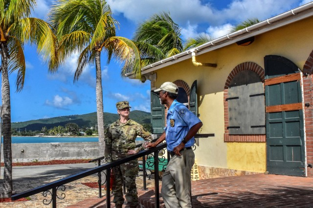Making prior coordination is essential to a complex readiness exercise. Sgt. Maj. Witt from the Michigan National Guard discusses port operations with authorities at Frederiksted, Virgin Islands. The Michigan National Guard is partnered with the Virgin Islands National Guard and civil authorities to conduct a Emergency Deployment Readiness Exercise to validate the capability to respond to an natural emergency.