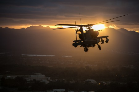 A U.S. Army AH-64 Apache helicopter flies in formation during a division run during Tropic Lightning Week at Schofield Barracks, Hawaii, Dec. 17, 2018. The 25th Infantry Division is celebrating its 77th birthday with their annual Tropic Lightning Week. The Division was formed, Oct. 1, 1941, at Schofield Barracks and saw combat during the Japanese attack across Oahu on Dec. 7, 1941.