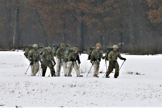 Students in the Cold-Weather Operations Course (CWOC) Class 19-01 complete a ruck march in snowshoes during course training Dec. 13, 2018, at Fort McCoy, Wis. CWOC students are trained on a variety of cold-weather subjects, including snowshoe training and skiing as well as how to use ahkio sleds and other gear. Training also focuses on terrain and weather analysis, risk management, cold-weather clothing, developing winter fighting positions in the field, camouflage and concealment, and numerous other areas that are important to know in order to survive and operate in a cold-weather environment. The training is coordinated through the Directorate of Plans, Training, Mobilization and Security at Fort McCoy. (U.S. Army Photo by Scott T. Sturkol, Public Affairs Office, Fort McCoy, Wis.)