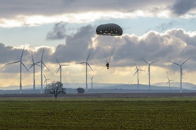 A paratrooper with an open parachute descends over Alzey Drop Zone during Operation Toy Drop in Alzey, Germany, Dec. 13. Operation Toy Drop is an annual multi-national training event designed to strengthen relations and develop interoperability.