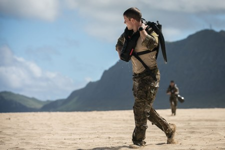 U.S. Army Rangers assigned to Bravo Company, 2nd Battalion, 75th Ranger Regiment, walk back to the equipment turn-in point on the beach following a helocast insertion at Bellows Air Force Station, Hawaii, Nov. 14, 2018. 25th Infantry Division Lightning Academy waterborne operations, off the coast of Hawaii, offers a unique training environment and partnership opportunity for United States Army Special Operations Forces and the 25th Infantry Division. (U.S. Army photo by 1st Lt. Ryan DeBooy)