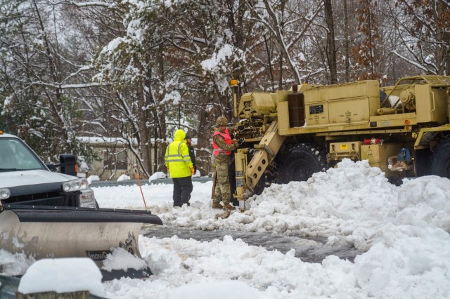 Soldiers assigned to the 690th Brigade Support Battalion assisted North Carolina Department of Transportation to recover temporarily disabled snowplows in Marion, N.C. during Winter Storm Diego, Dec. 9, 2018. 175 NCNG Soldiers are strategically placed across N.C. to augment the Department of Transportation, N.C. Emergency Management and local first responders in Winter Storm recovery operations.