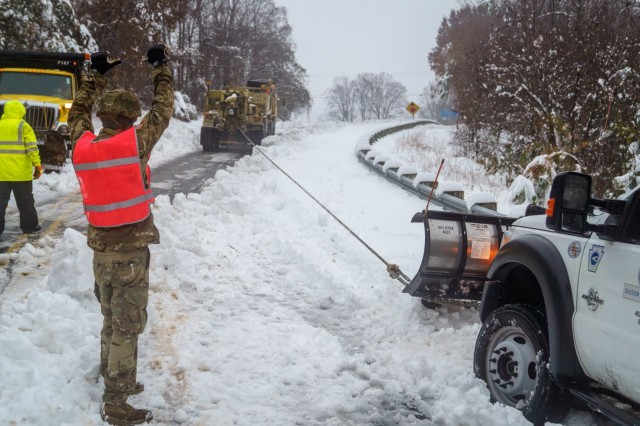 U.S. Army Sgt Joey Rose, assigned to the 690th Brigade Support Battalion, directs a recovery vehicle in Marion, N.C. during Winter Storm Diego, Dec. 9, 2018. 175 NCNG Soldiers are strategically placed across N.C. to augment the Department of Transportation, N.C. Emergency Management and local first responders in Winter Storm recovery operations.