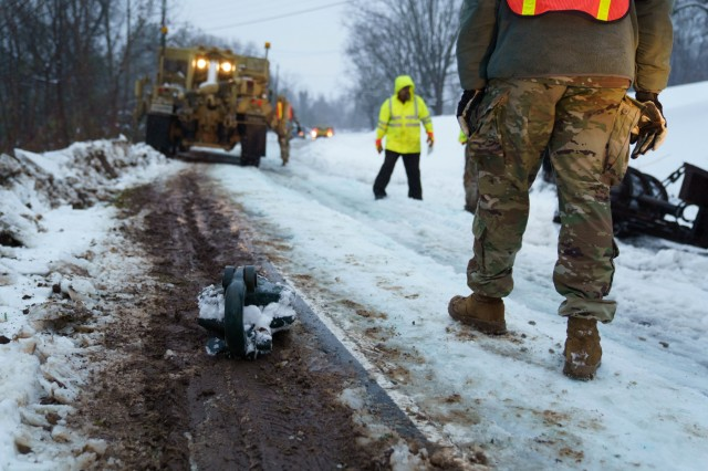 A Soldier assigned to the 690th Brigade Support Battalion, stood beside a 10-ton snatch block pulley used for vehicle recovery while assisting the North Carolina Department of Transportation in Marion, N.C. during Winter Storm Diego, Dec. 9, 2018. 175 NCNG Soldiers are strategically placed across N.C. to augment the Department of Transportation, N.C. Emergency Management and local first responders in Winter Storm recovery operations.