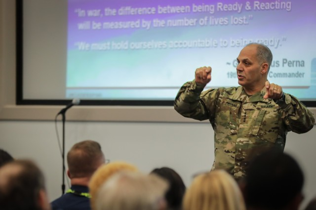 Gen. Gus Perna, commanding general, Army Materiel Command, updates employees on changes impacting the organization during an AMC town hall, Dec. 18, 2018 at Redstone Arsenal, Ala. Gen. Perna reviewed internal reorganization, realignment of the medical materiel logistics mission to AMC and more. (U.S. Army Photo by Eben Boothby)