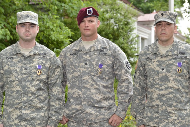 Sgt. Sean Karpf, center, poses for a photo after receiving the Purple Heart in a ceremony at Mt. Vernon, Va., June 10, 2013. Karpf, who now works as a strength and conditioning associate for the Jacksonville Jaguars, lost his lower left leg after he stepped on a pressure plate that detonated a buried bomb in Afghanistan.
