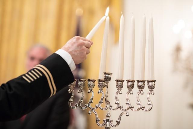 1st Inf. Div. senior chaplain lights White House menorah